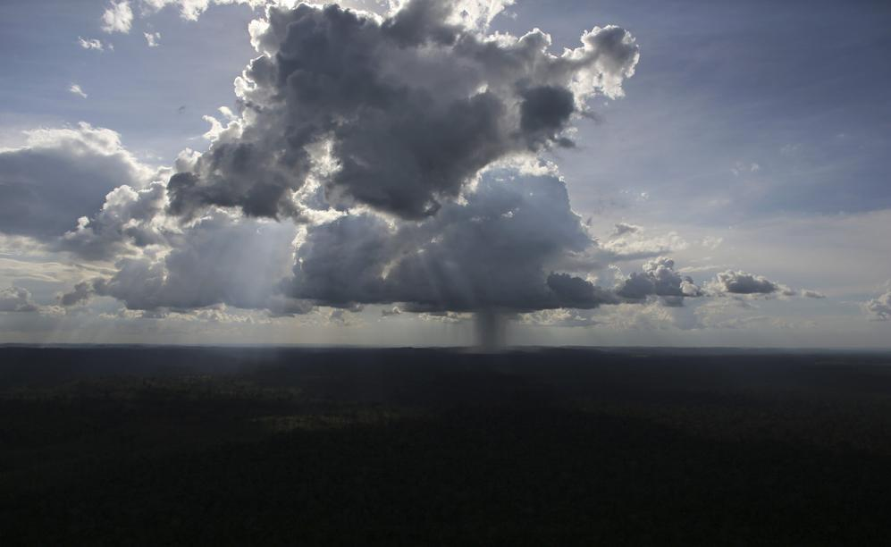 A thunderstorm is seen over the Amazon rainforest near the city of Novo Progresso